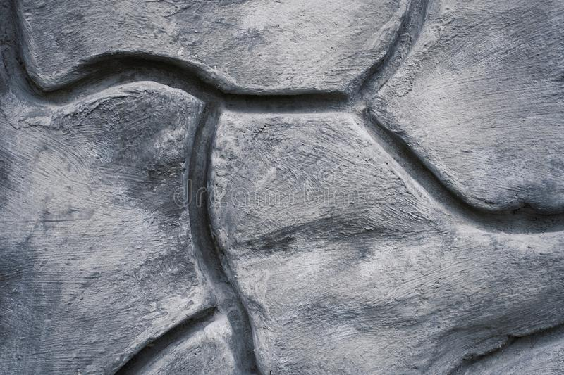 Geometric decorative pattern texture on cement concrete wall royalty free stock photography