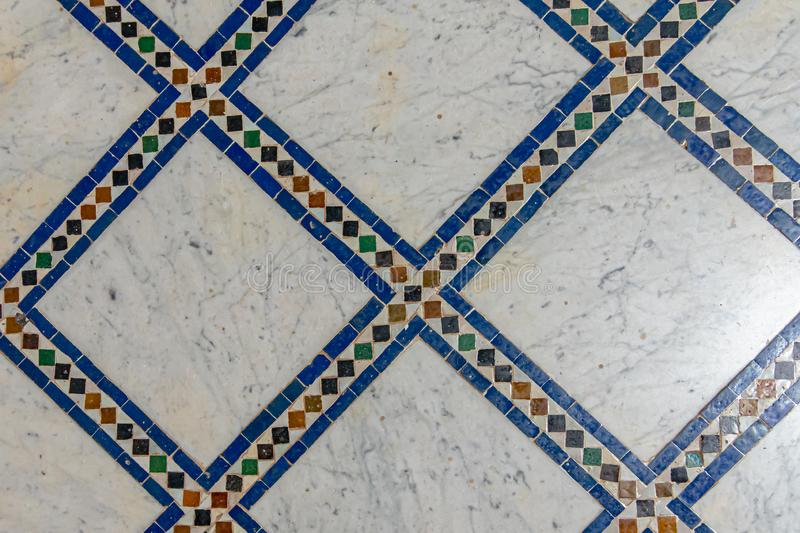 Geometric detail of decorative square floor with blue colors royalty free stock photo