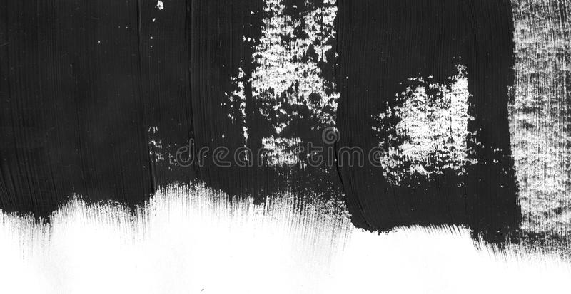 Geometric graffiti abstract background. Wallpaper with oil watercolor effect. Black acrylic paint stroke texture on. White paper. Scattered mud art. Macro image royalty free stock photography