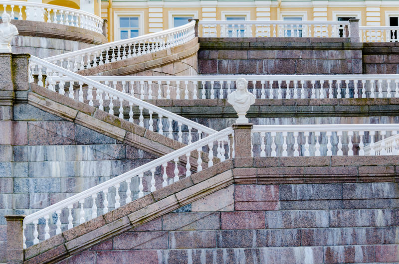 Geometric lines with white balustrades and railings on the marble stairs of the Palace in Oranienbaum stock images