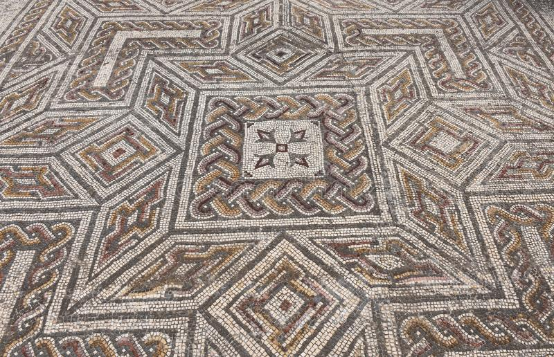 Geometric mosaic of the roman ruins of the ancient city of Conimbriga, Beiras region, Portugal stock photos