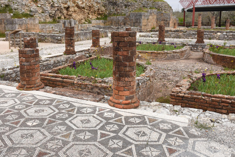 Geometric mosaic, Roman ruins of the ancient city of Conimbriga, Beiras region, Portugal royalty free stock images