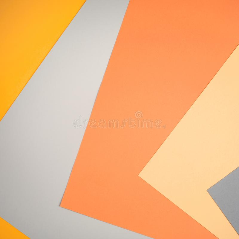 Geometric paper background in autumn tones. ascending diagonals of gray, beige, yellow, orange colors. royalty free stock photo