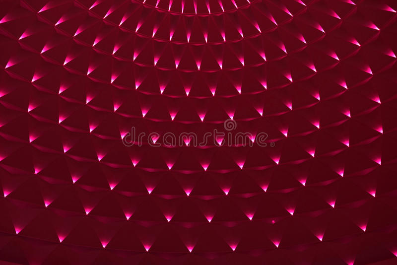 Geometric pattern on circular top of modern building. Geometric pattern on circular ceiling of modern building lit by red led lights, interior of great shopping stock photos