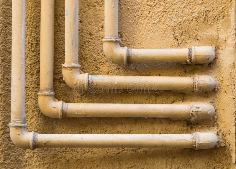 Geometric pattern of 90 degree water pipes and fittings royalty free stock image