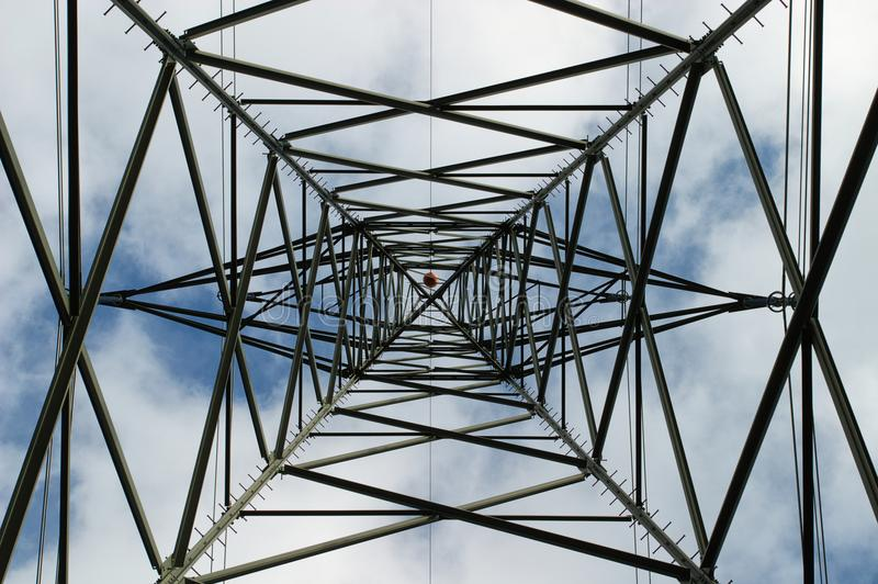 Geometric Pattern in an electricity pylon. The view from underneath an electricity pylon or transmission tower yields an intricate pattern of interconnected