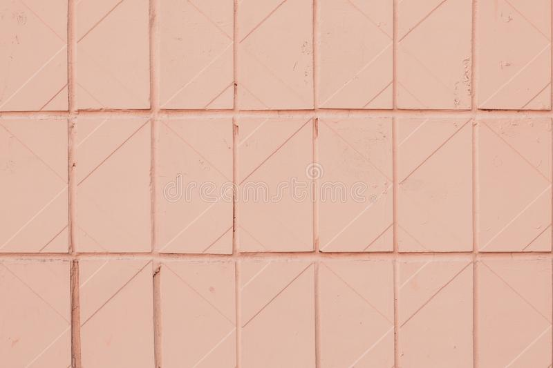 Geometric pattern of soft pink tile. Texture of orange pastel ceramic tiled. Light color  backgrounds with square. Design of bathr stock photography
