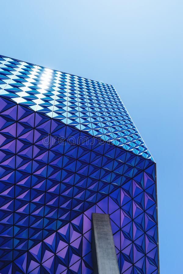 Geometric patterned blue building royalty free stock images