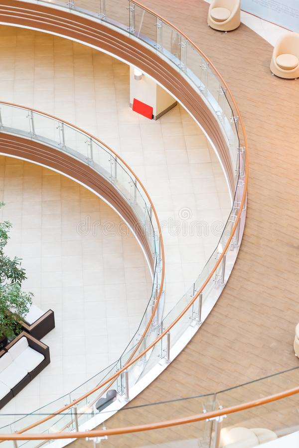 Geometric patterns from multi-level balconies in the architecture of an empty shopping center building.  stock photography