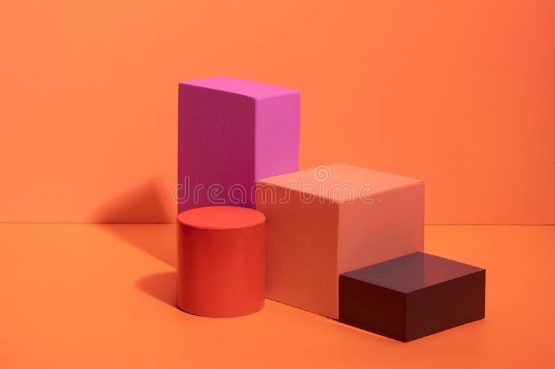 Geometric shapes in different colors on orange background. stock images
