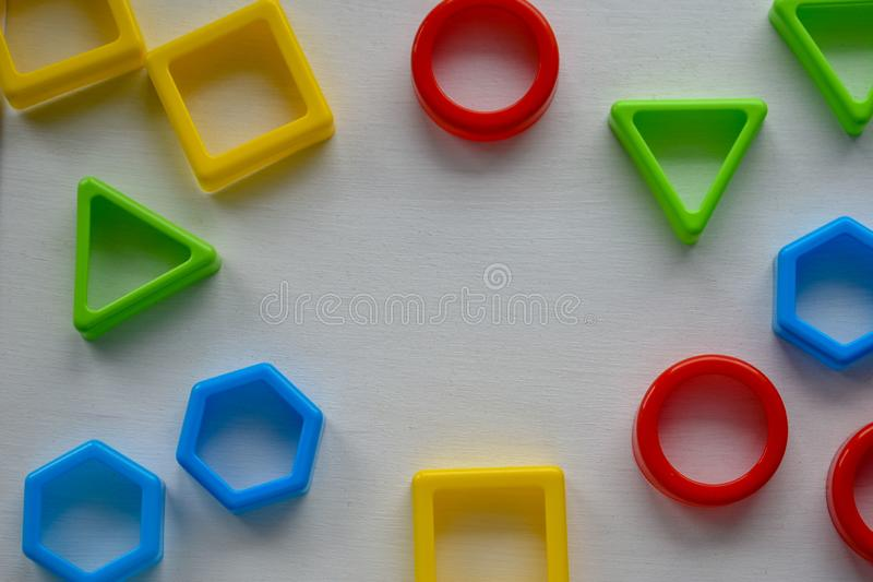Geometric shapes in different colors, top view. Concept of creative, logical thinking or problem solving royalty free stock photo