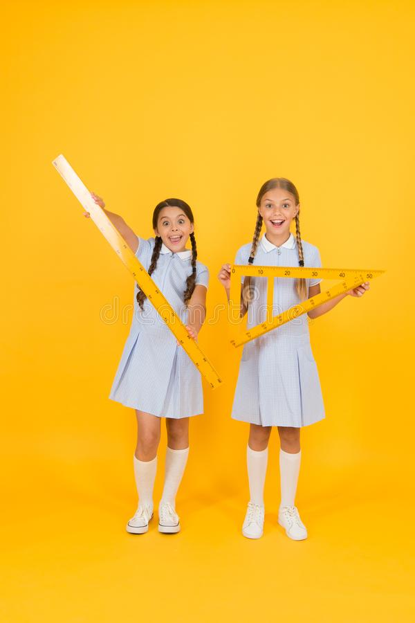 Geometric shapes. small girls love geometry. old school. modern education. happy friends in retro uniform. vintage kid royalty free stock photography