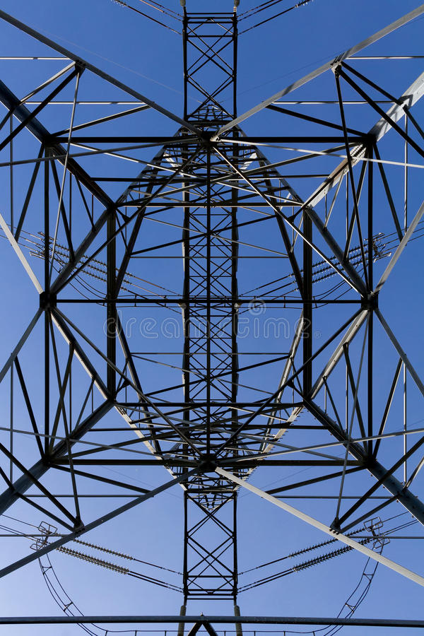 Geometric transmission tower from below royalty free stock images
