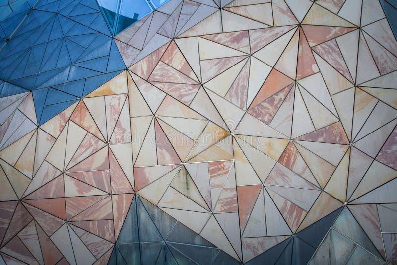 Geometric triangle pattern background on wall. Geometric triangle pattern background texture stock image