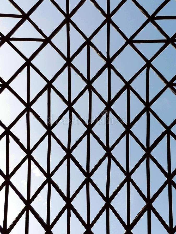 Geometric unusual structure with crossed wooden bars. royalty free stock photography