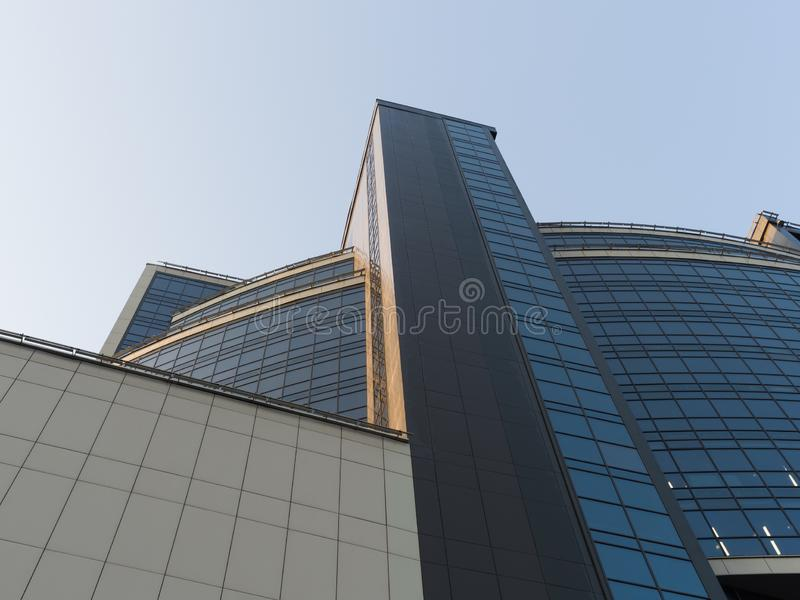 Geometric volumes of a business building against the sky. Theme of modern developing cities royalty free stock photos