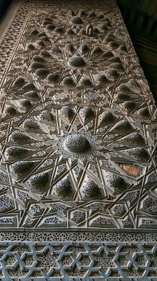 Geometrical engraved bronze decorations of the main entrance of Al Moaayad mosque, Cairo, Egypt. Geometrical engraved bronze-plate decorations of the main stock photos