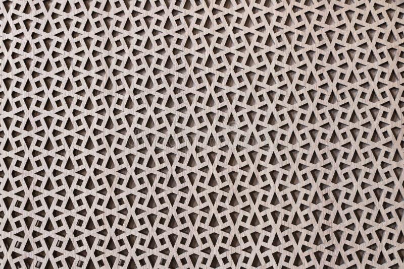 Geometrische die patronen, Islamitisch-Stijlornament met okkernootvernisje wordt behandeld stock afbeelding