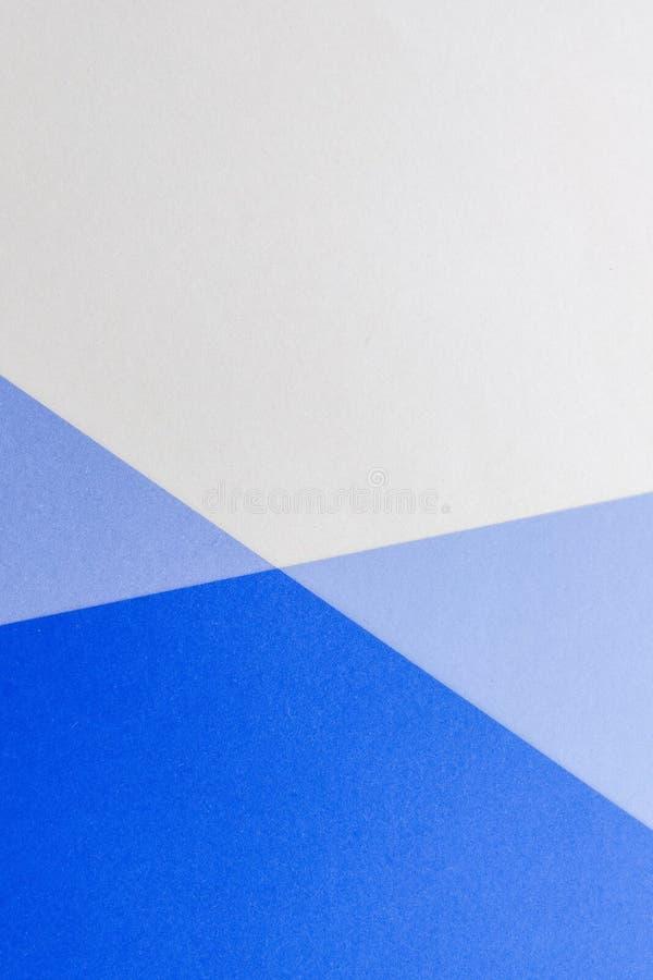 Geometrisk grafisk bakgrund för slätt med kulört papper royaltyfria bilder