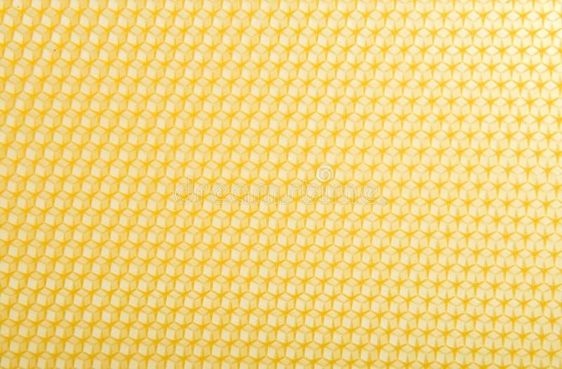 Geometriskt proportionell texturfördjupninghonung royaltyfri bild