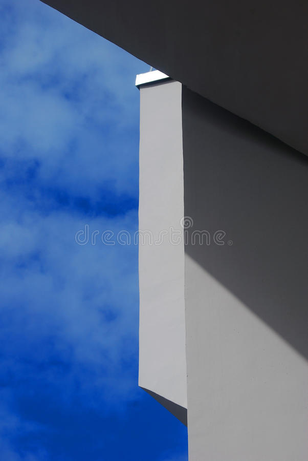 Geometry of architecture. Blue sky background. Shadow play. Taken in Moscow, Russia stock photography