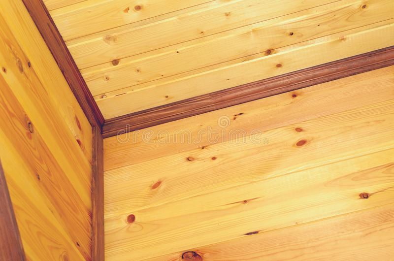 Geometry from eco-friendly wooden ceiling skirting boards. Geometry from eco-friendly wooden ceiling skirting boards royalty free stock image