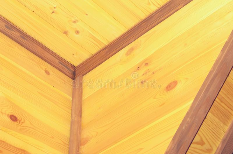 Geometry from eco-friendly wooden ceiling skirting boards. Geometry from eco-friendly wooden ceiling skirting boards royalty free stock photos