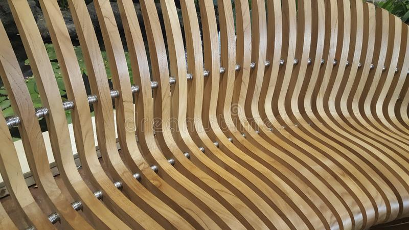 Geometry of Modern Furniture. The geometry of modern furniture is demonstrated by the wooden slatted seat stock image