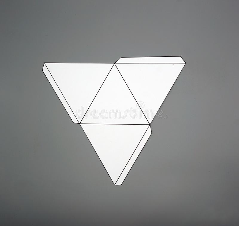Geometry net of pyramid. 2-dimensional shape that can be folded to form a 3-dimensional shape or a solid. Unfolded three Dimensional Figures. Isolated. Top view stock photography