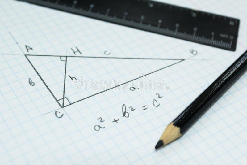 Geometry, the Pythagorean theorem in a school notebook royalty free stock image