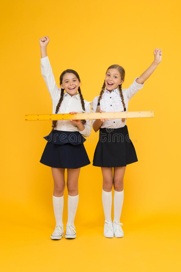 Geometry school lesson. Teamwork concept. Close or far. Measuring skills. Measuring distance. Measuring equipment. Kids royalty free stock photos
