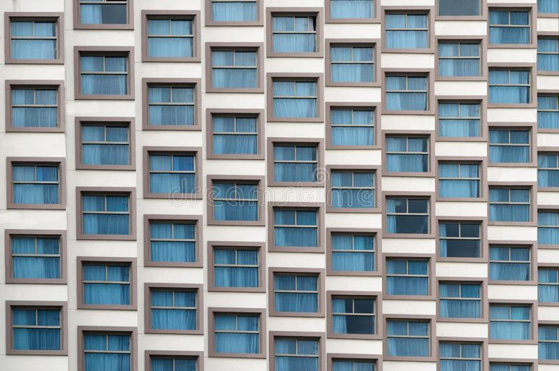Geometry of Windows on the facade of a modern building, Nha Trang. stock images