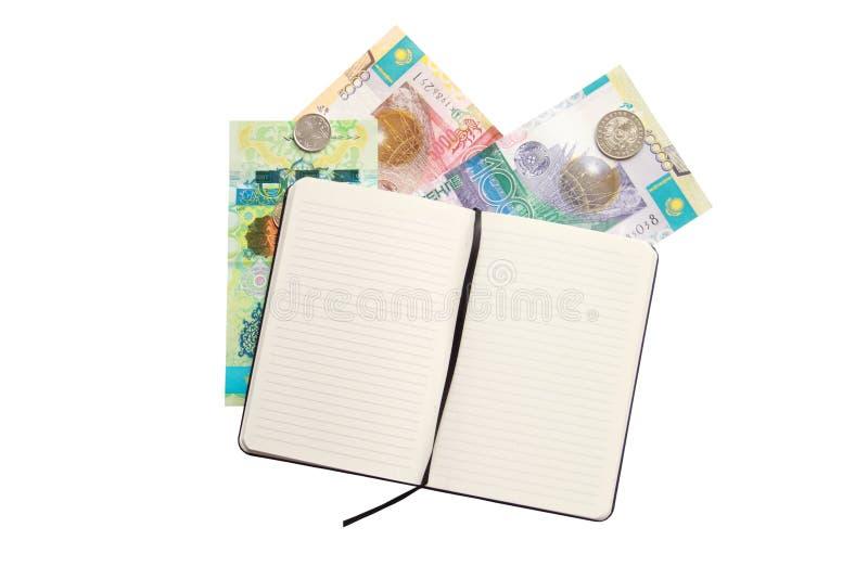 Geopend notitieboekje en wat geld van Kazachstan over royalty-vrije stock foto