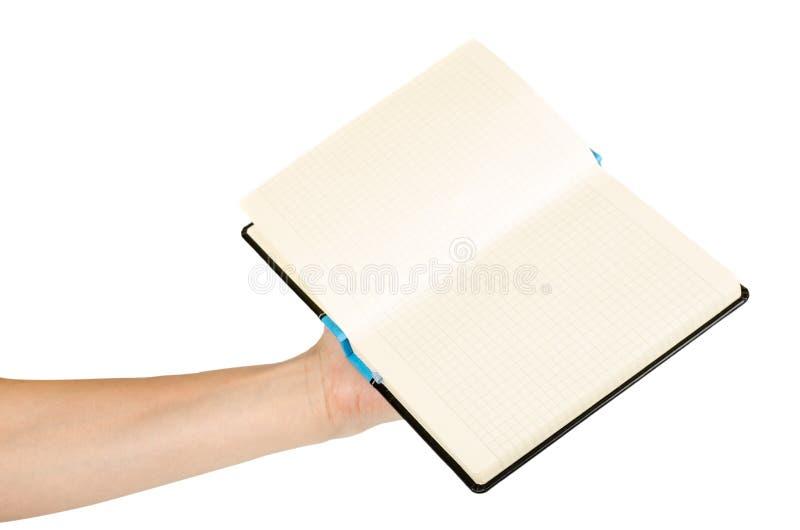 Geopend zwart die notitieboekje met hand, op witte achtergrond wordt geïsoleerd royalty-vrije stock afbeeldingen