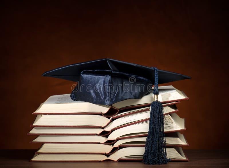 Geopende boeken met graduatie GLB stock fotografie