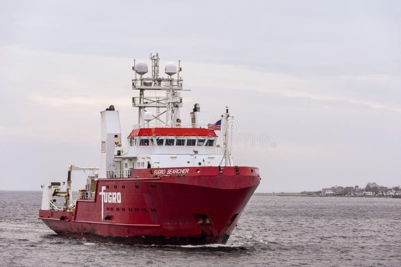 Geophysical survey vessel Fugro Searcher crossing New Bedford outer harbor. New Bedford, Massachusetts, USA - November 12, 2019: Offshore surveying vessel Fugro royalty free stock photo