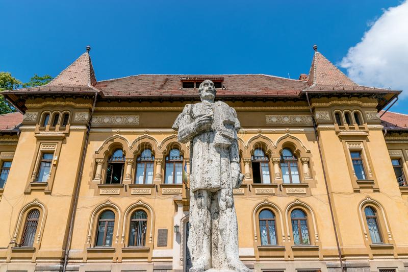 George Baritiu statue in front of the George Baritiu School in Brasov, Romania royalty free stock images