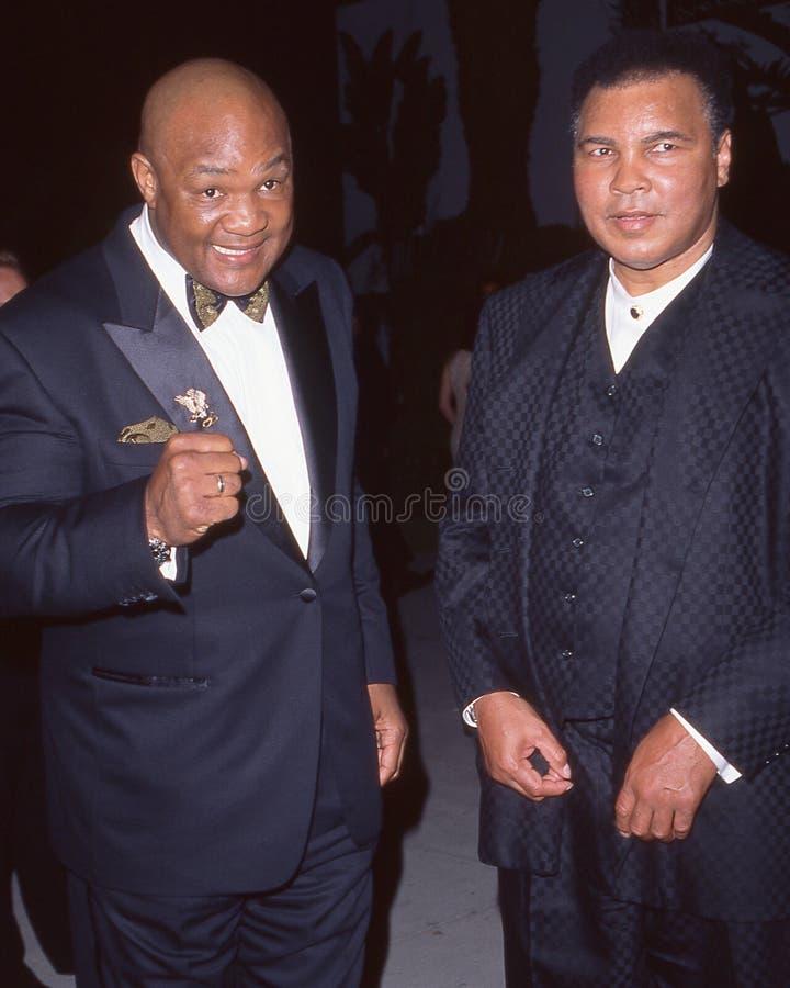 George Foreman en Muhammad Ali stock afbeelding