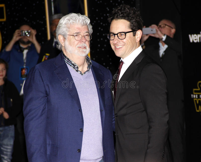 George Lucas and J.J. Abrams. HOLLYWOOD, CA - George Lucas and J.J. Abrams at the World premiere of 'Star Wars: The Force Awakens' held at the TCL Chinese royalty free stock photos