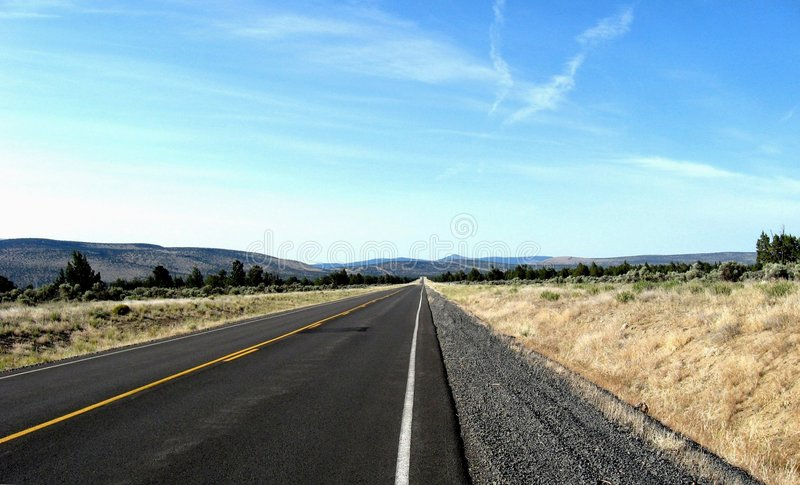 George Millican Road. Milepost 10 looking south -- George Millican Road is part of a 30 mile stretch of asphalt that reaches from Prineville Airport at its north royalty free stock photos