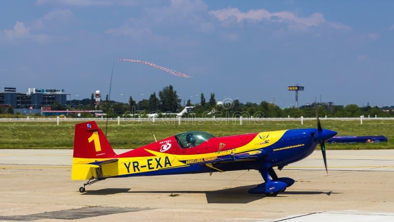 George Rotaru (Leader) with YR-EXA. George Rotaru (Hawks of Romania) with YR-EXA after aerobatics at Bucharest International Air Show 2013 royalty free stock image