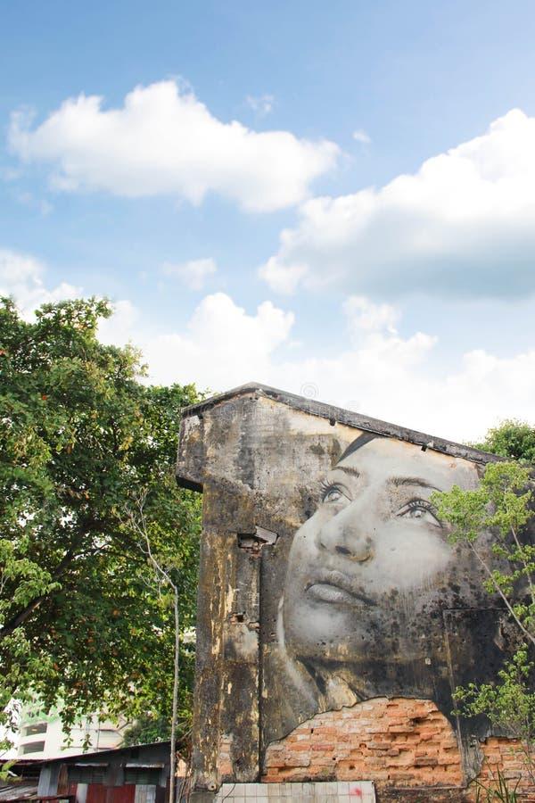 GEORGE TOWN, MALASIA - 6 DE JUNIO DE 2015: Pintura de la cara de la mujer en b foto de archivo