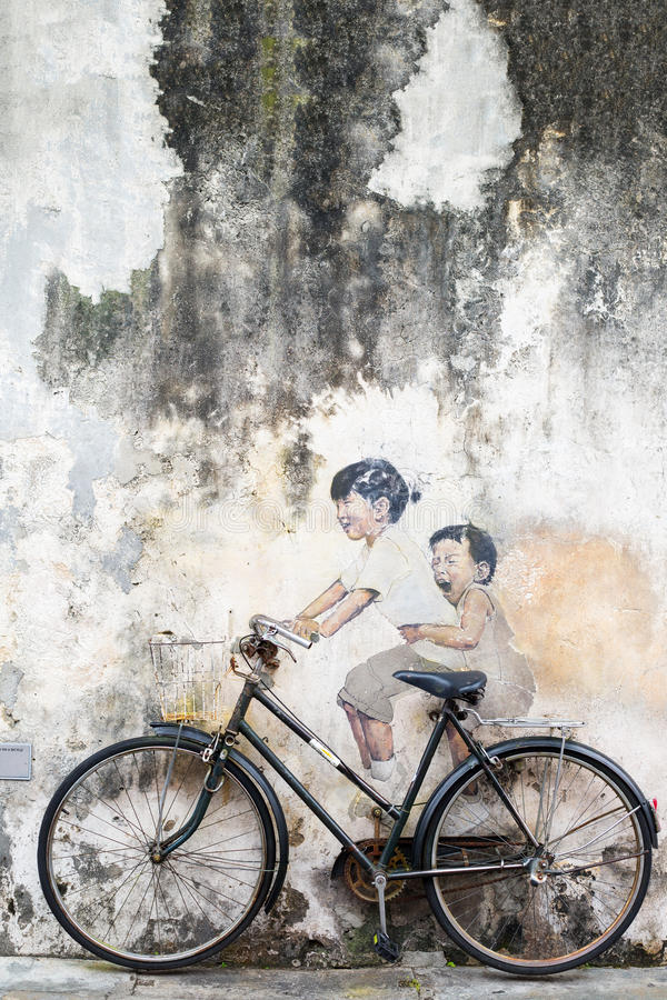 GEORGE TOWN,PENANG ,MALAYSIA- CIRCA October 23, 2015: Public st. Reet art Name Children on a bicycle painted 3D on the wall that's two little Chinese girls stock photo