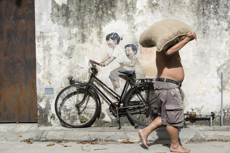 George Town, Penang, Malaysia, December 19 2017: `Little Children on a Bicycle` street art stock photo