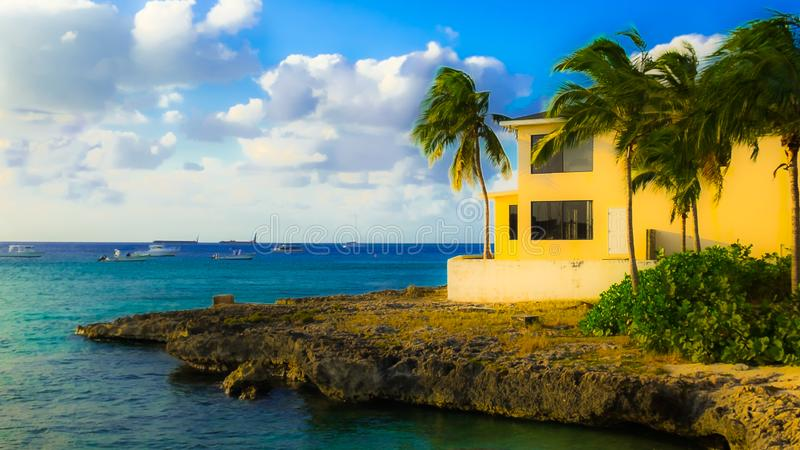 George Town Seashore-Yellow House. Grand Cayman, Cayman Islands, Nov 2016, yellow house in George Town by the Caribbean Sea royalty free stock images