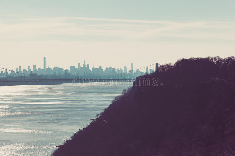 George Washington Bridge and the New York Skyline from Palisades. The George Washington Bridge and New York Skyline can be seen from Palisades Interstate Parkway royalty free stock photography