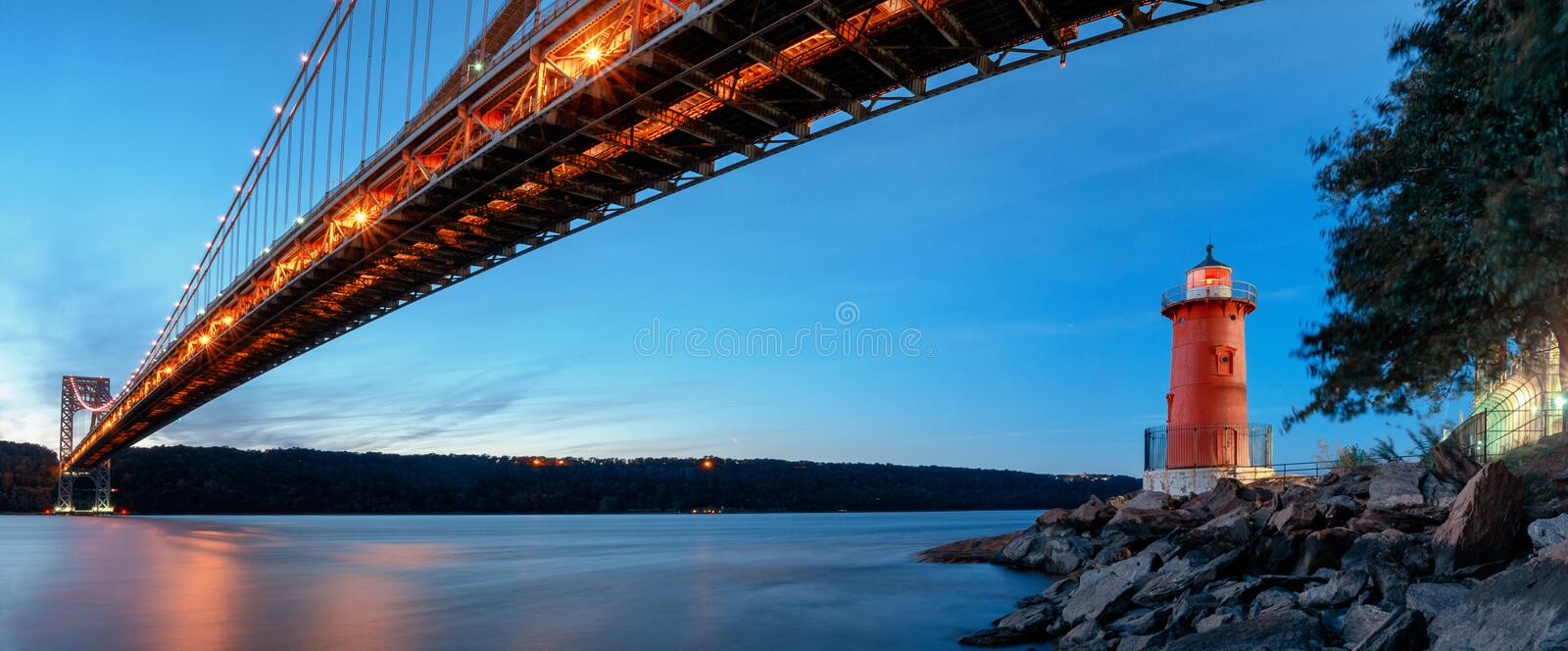 George Washington Bridge and Red Little Lighthouse officially Jeffrey`s Hook Light, New York, USA royalty free stock image