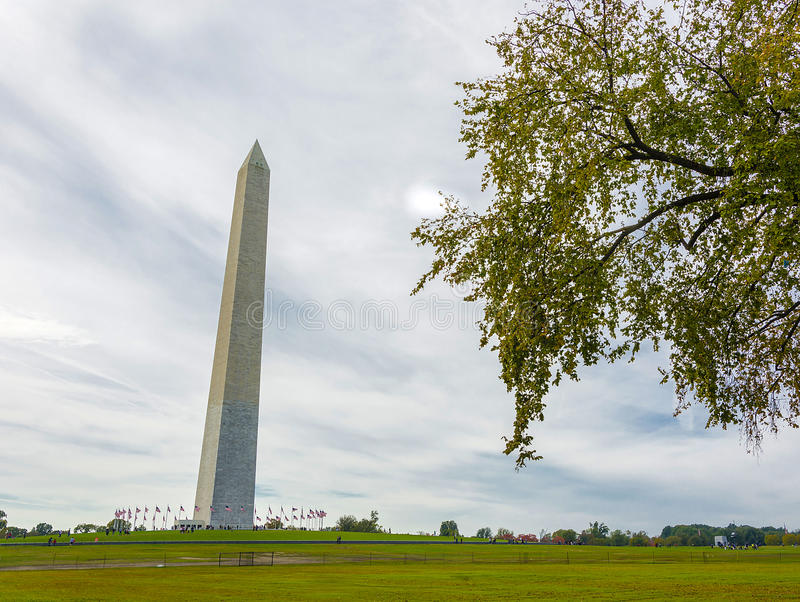 George Washington monument with trees stock images