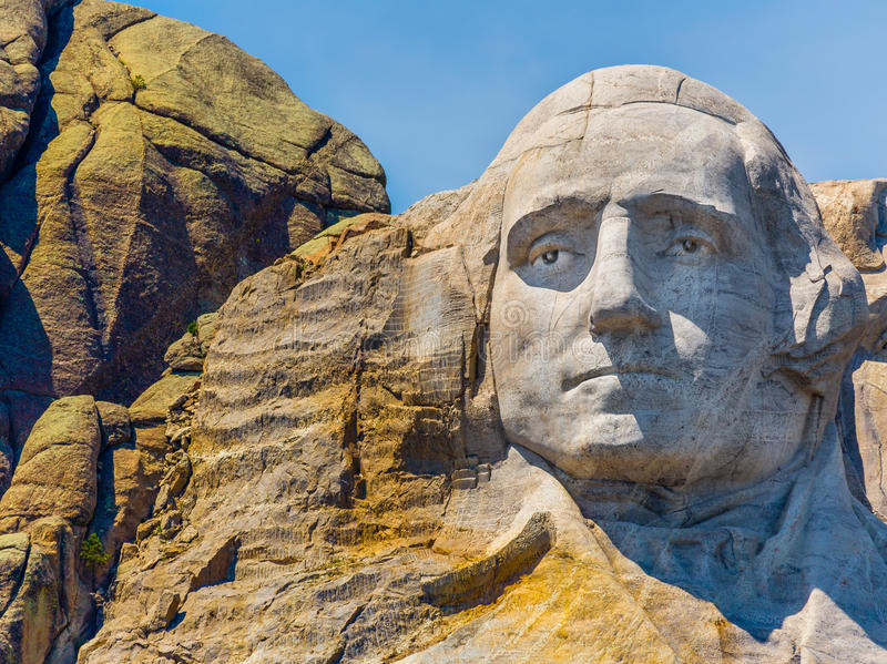 George Washington Portrait carved on Mount Rushmore. The first American President, the founding father of the United States of America, George Washington, carved royalty free stock images