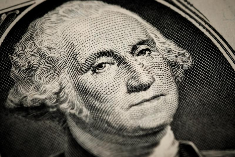 George Washington`s portrait on one 1 american dollar bill. Macro close up view royalty free stock images